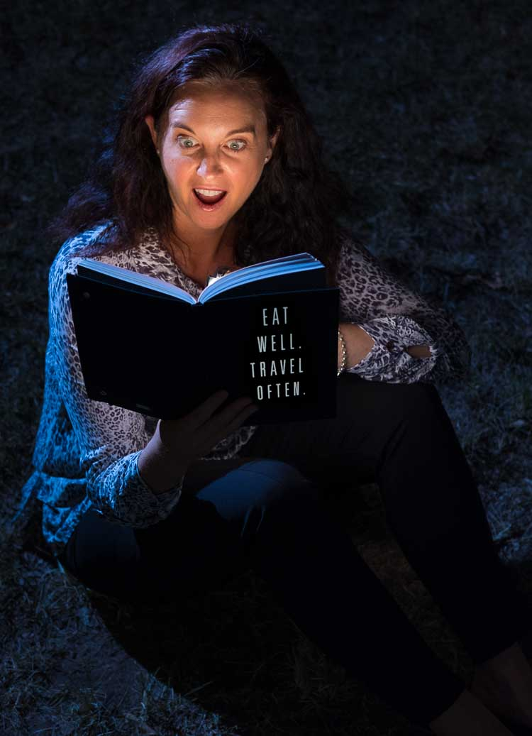 A lady reads a magical book - photo for a blog avatar