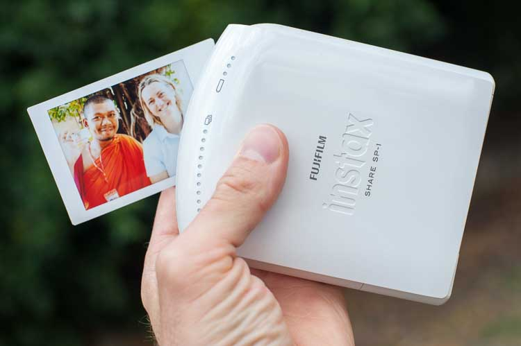 FujiFilm Instax SP-1 instant printer with a print