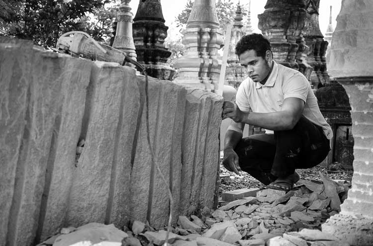 A stonemason carves an elephant at Wat Bo, Siem Reap, Cambodia