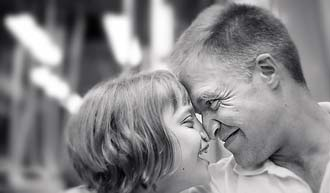 Black and white photo of father and daughter together