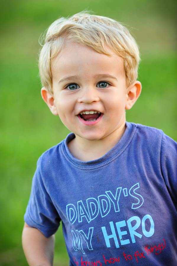 a boy with Daddy's Hero tee shirt