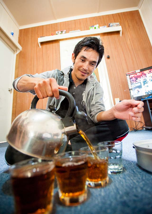 A man pours tea at home in Australia - Afghan style