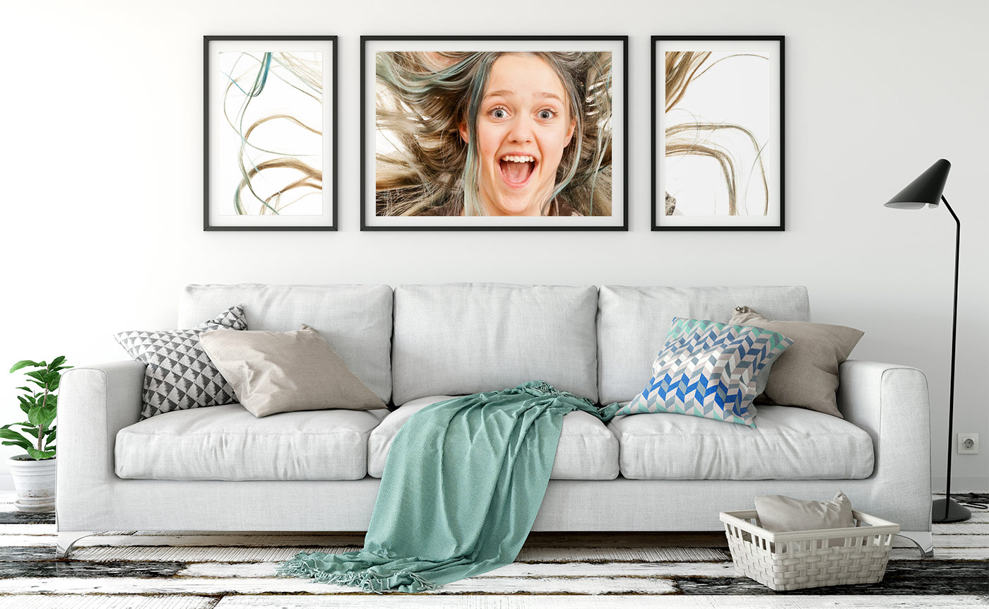 Printed, framed photos on the living room wall