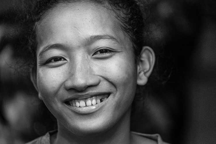 Street portrait of a lady in Cambodia at night