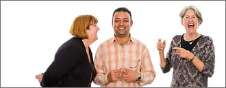White background portrait of three people laughing